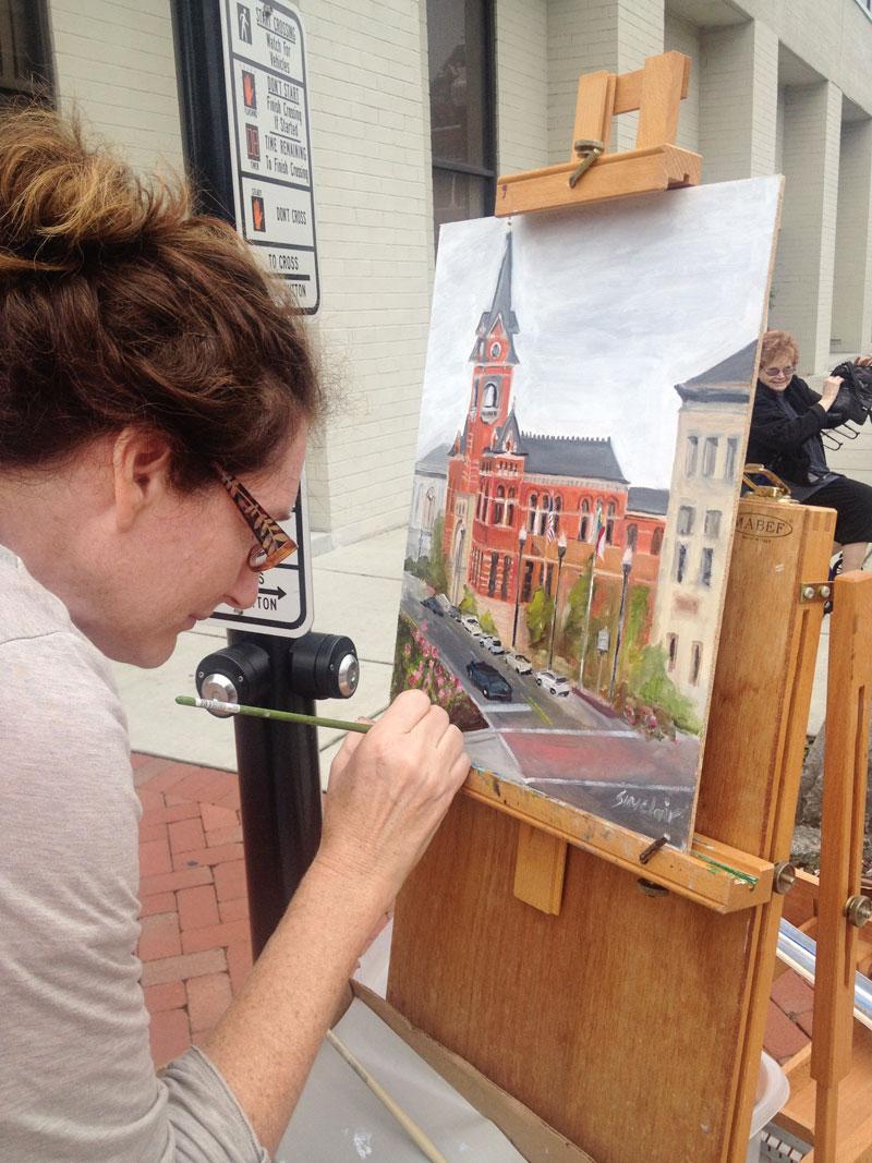 Local artist captures 3rd Street in plein-air painting