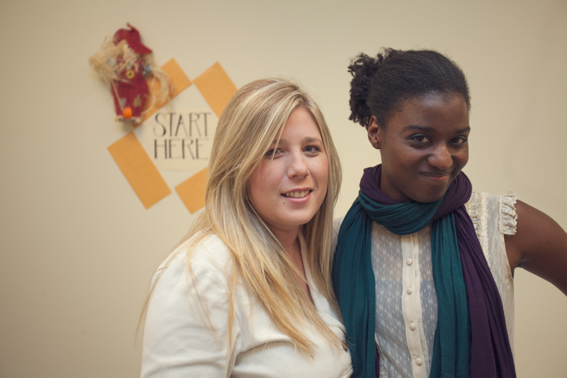 Lourdes (Accounting) and Kenyatta (Reception) pose for a moment during chat time