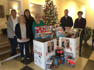 Wells Insurance collecting Toys for Toys for Tots